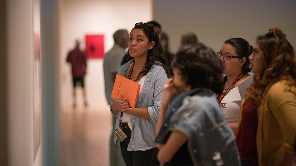 Group of young women admiring work at the ASU Art Museum